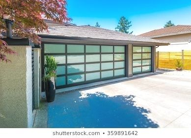 Garage with wide long nicely paved driveway