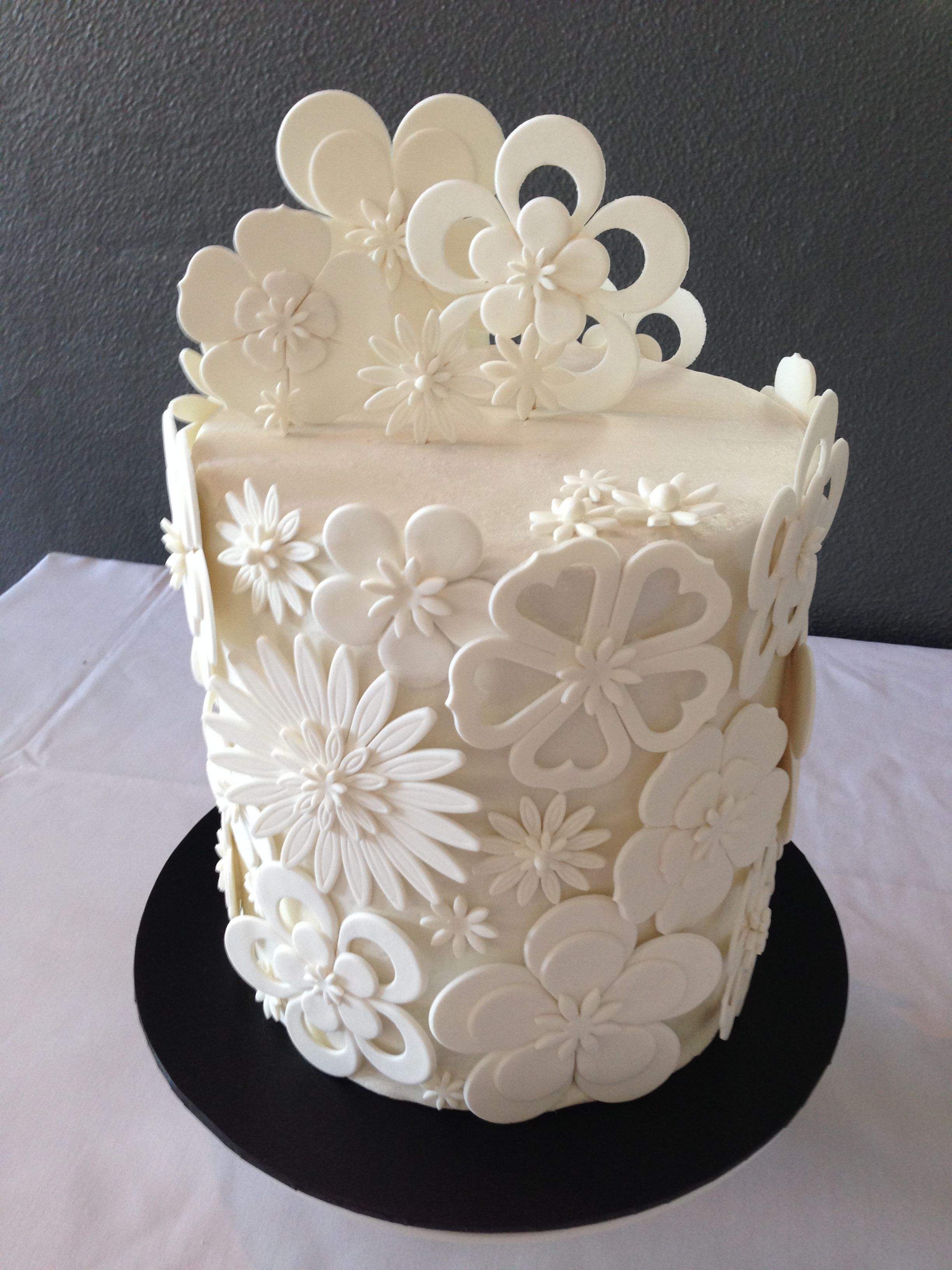White Cut Out Flower Wedding Cake A Double Barrel Chocolate Mud with ...