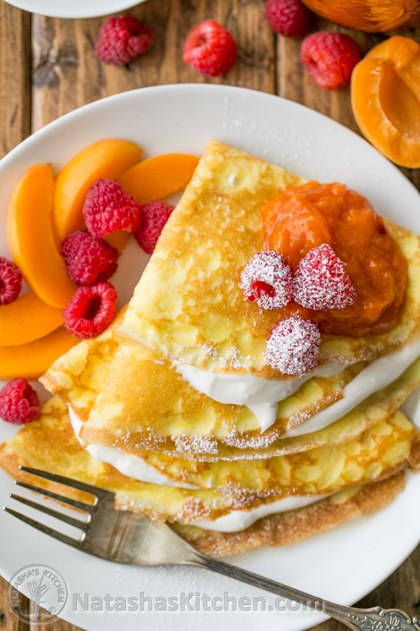 Crepes with Greek yogurt cream served with apricot raspberry sauce and plenty of fresh fruit!