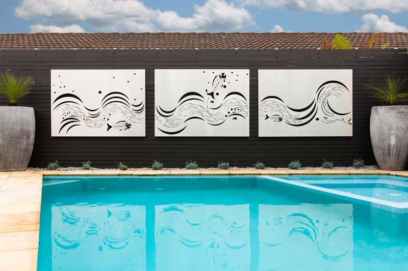 "Laser cut outdoor wall art. ""Fish Wave' feature panels in"