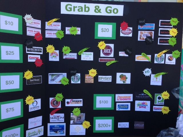 Grab & Go fundraising board filled with gift cards from local ...