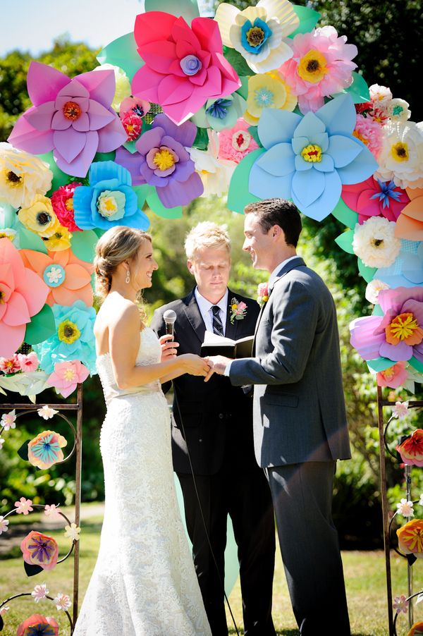 Paper flowers as decorations at this Colorful Wedding with Sweet DIY Details! on http://pizzazzerie.com @Courtney Baker Whitmore   Pizzazzerie.com