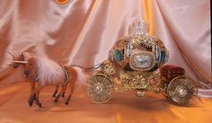 The Cinderella  carriage eggs are covered with vintage/antique fine jewelry and loose stones, 23K goldplated embellishments, Swarovski stones.  Inside is completely decorated floor to ceiling in great detail. The chassis are my own design and I customize horses for each carriage.