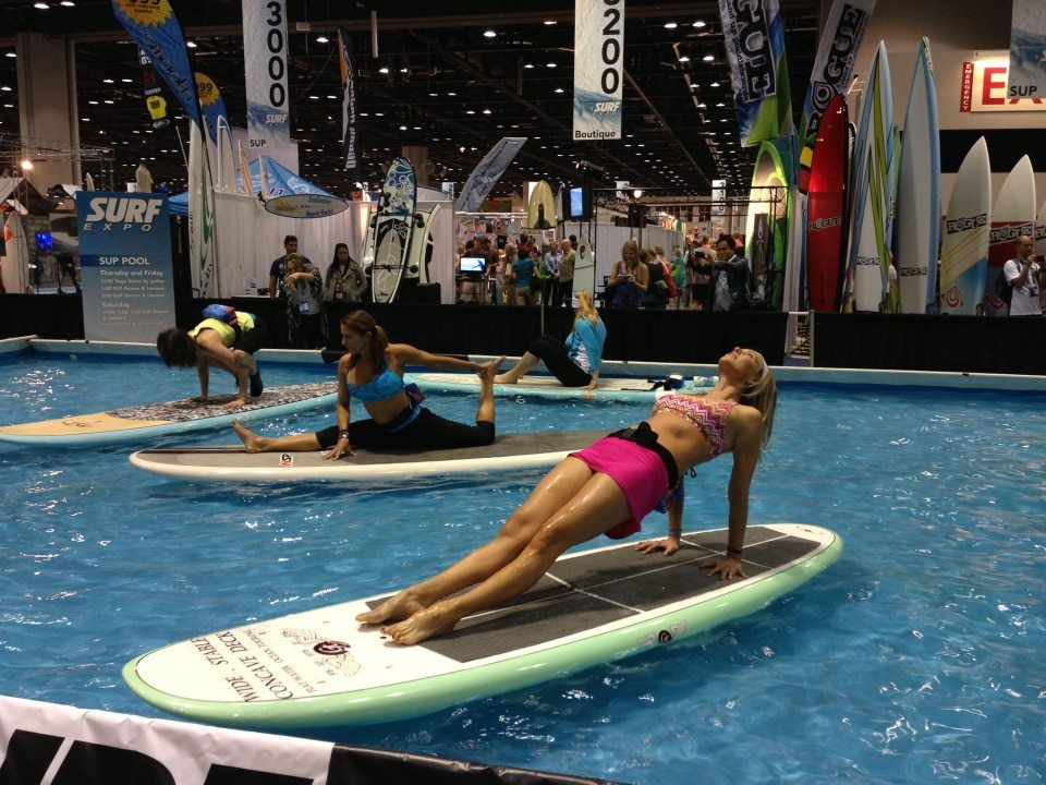 Yoga Sup trade show. Florida Stand Up Yoga. Pool Yoga on a