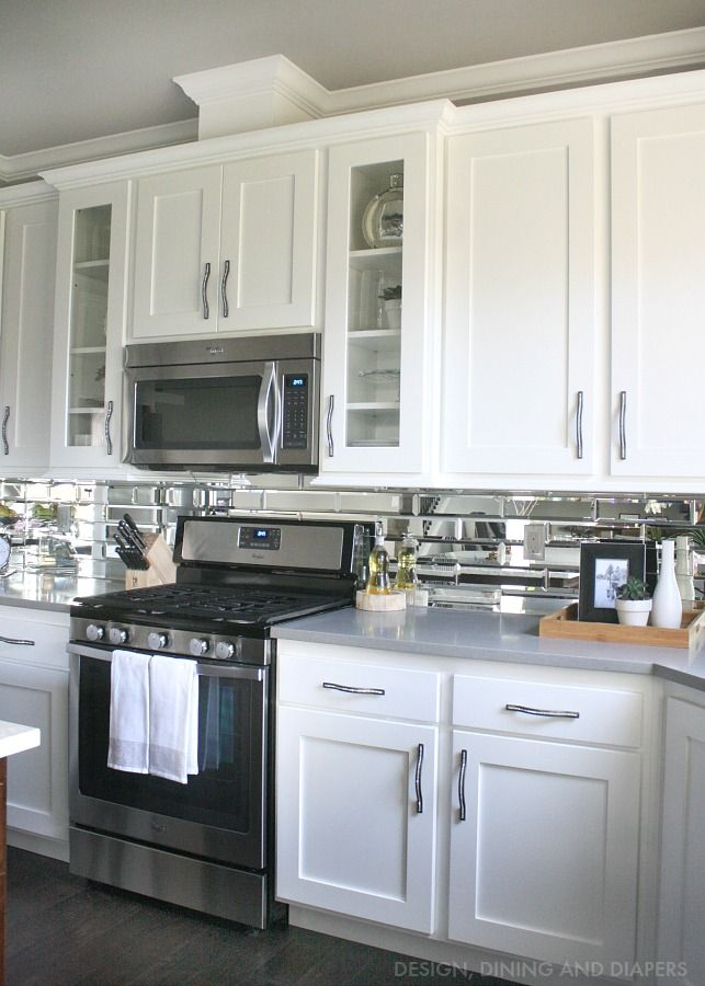 White Cabinets Mirror Backsplash Dark Floors And Gray Countertops