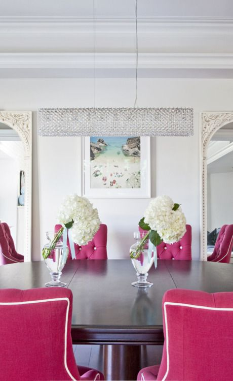 hot pink tufted dining room chairs. white piping This would be a really cool conference room.