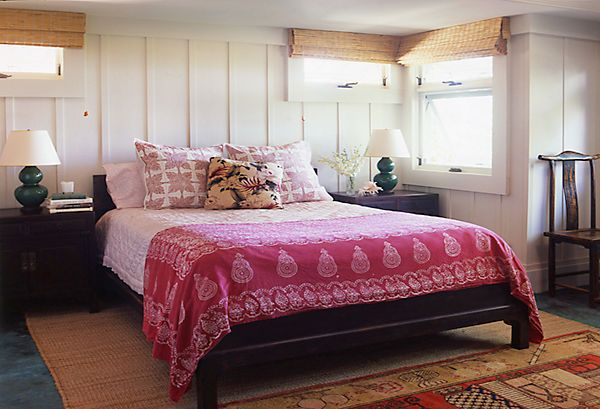 A simple beach-house bedroom is the perfect canvas for Indian-inspired bedding and pillows.