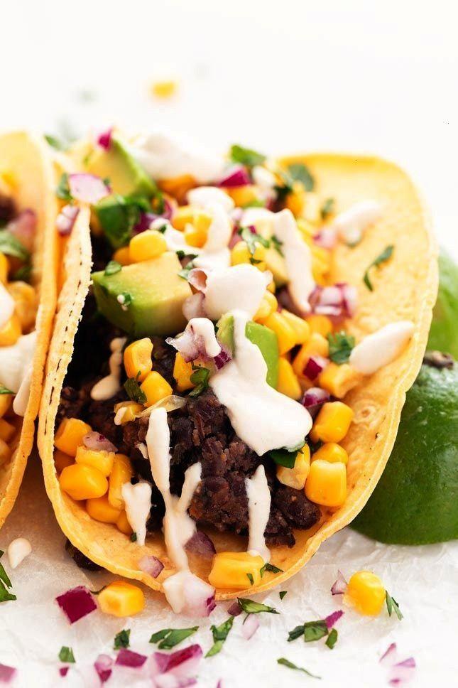 Tacos Vegan tacos, made with corn or flour tortillas, black beans, corn, avocado, and vegan sour cr