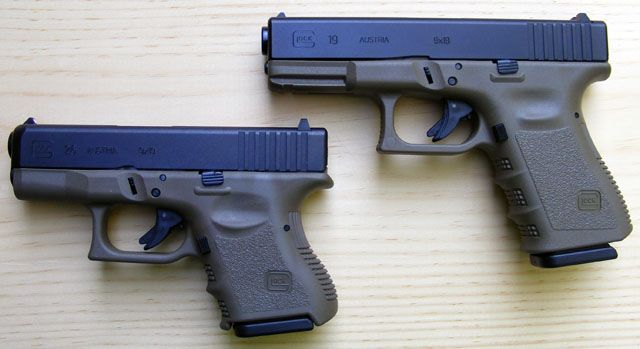 Glock 26 and 19 gray frame and blue top. | Shoot like a girl ...