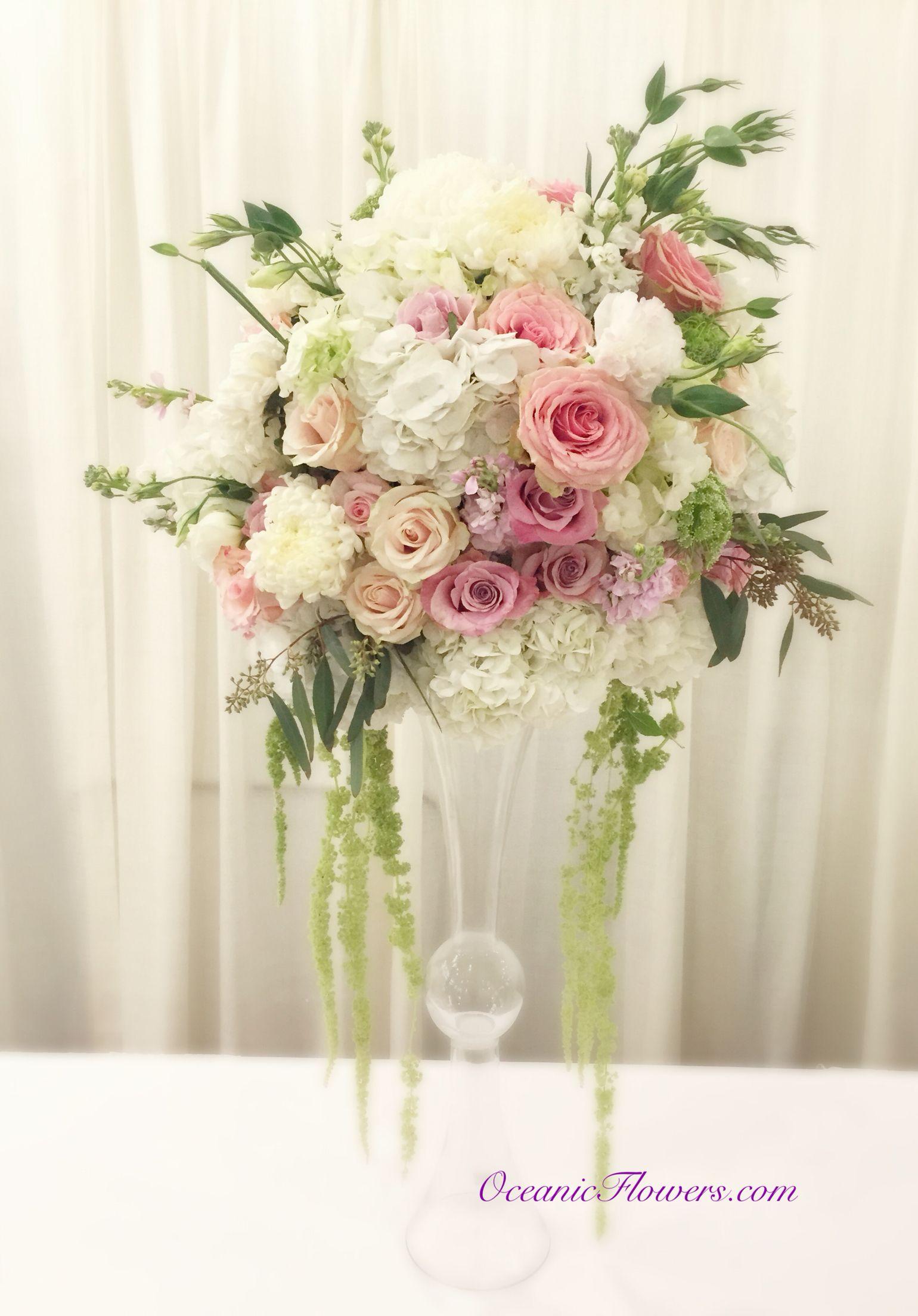 Large sporadic centerpiece arrangement on a double trumpet vase ...