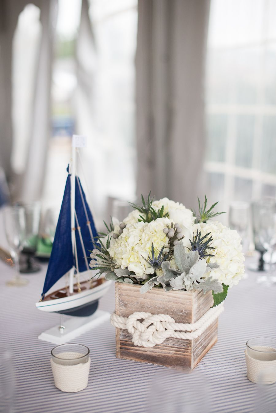 Love the rope detail on the candle and centerpiece, LOVE the ticking ...