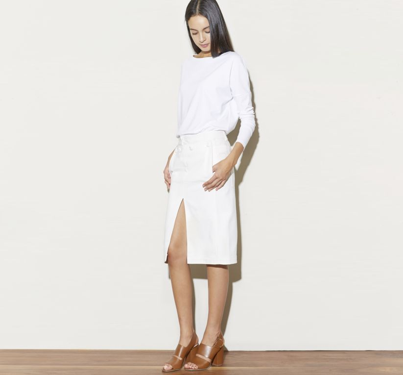 9aa54a41205db T by Alexander Wang Lux Crew Neck Long Sleeve Tee in White. Acne Studios  Drift Skirt in White. Alexander Wang Sara Slingback Sandal in Beige.