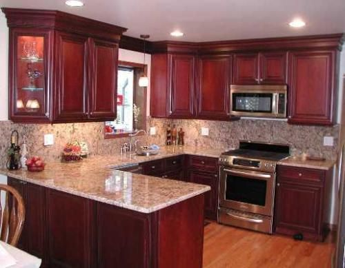 Steel Grey Granite Countertops And Backsplash With Cherry Cabinets