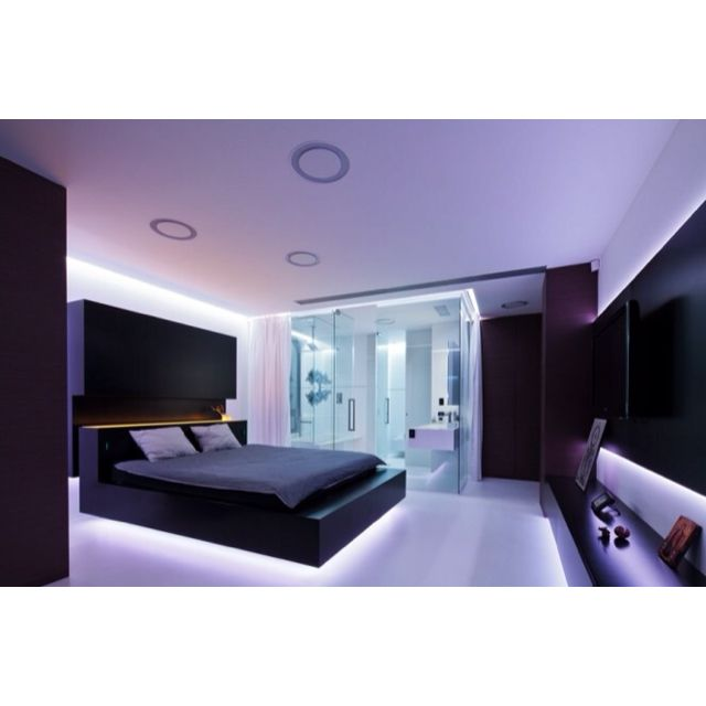 The lighting looks very nice in this bedroom. Is that bed ...