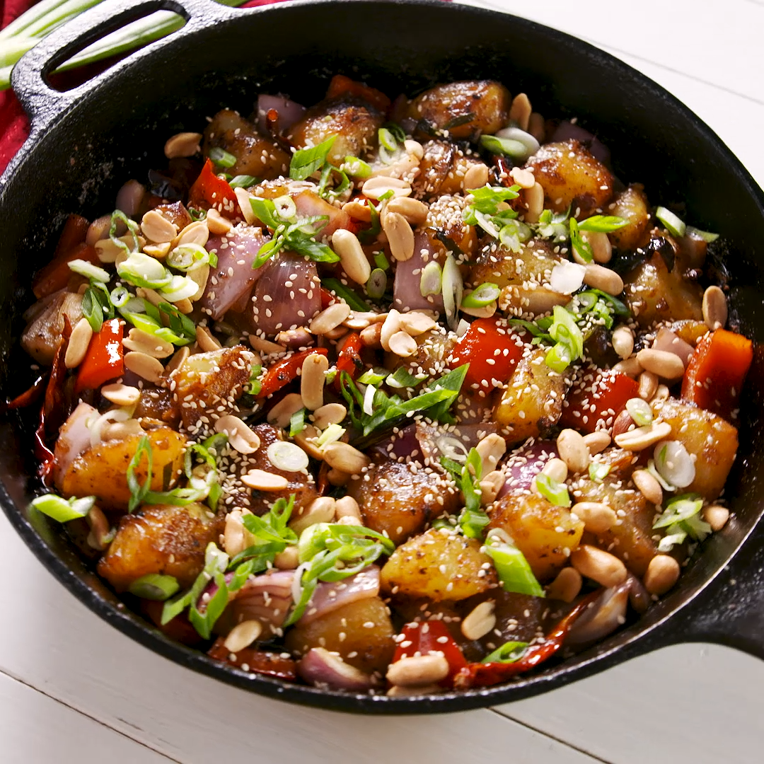 If you're a big fan of sassy Kung Pao Chicken, this vegetarian version is definitely worth a try for your next weeknight dinner. Get the recipe at Delish.com. #delish #easy #recipe #kungpao #chinesefood #potatoes #vegetarian #veggie #peanuts #sesame