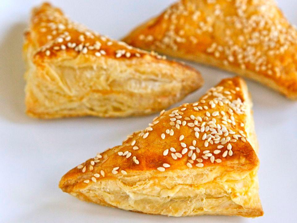 Recipe for Cheese Bourekas filled with creamy and salty feta cheese, kashkaval, & ricotta. Bureka, boreka, borek, savory hand pies. Kosher, dairy