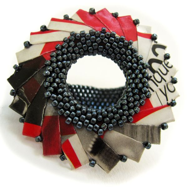 Ring | Francesca Vitali. Recycled Paper, hematite beads; origami, peyote stitched