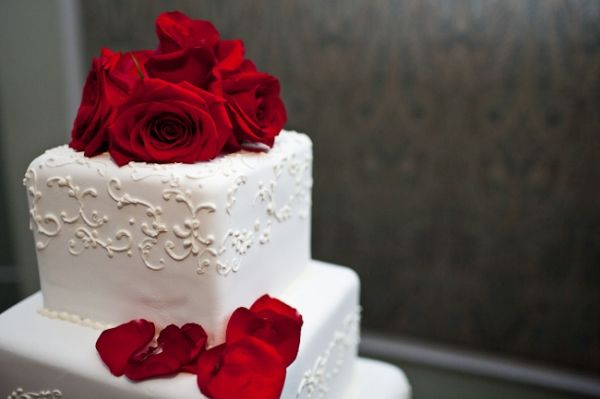 Red roses on plain white with scrolls