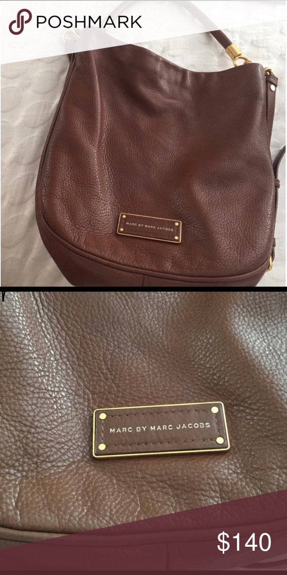 b66b436ea7 Gorgeous brown Marc by Marc Jacobs handbag Preowned and preloved💕 Marc by marc  Jacobs bag no tears or stains comes with long strap.
