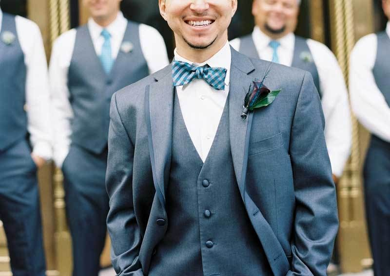 Grooms Suit In Charcoal Gray With Teal And Bow Tie