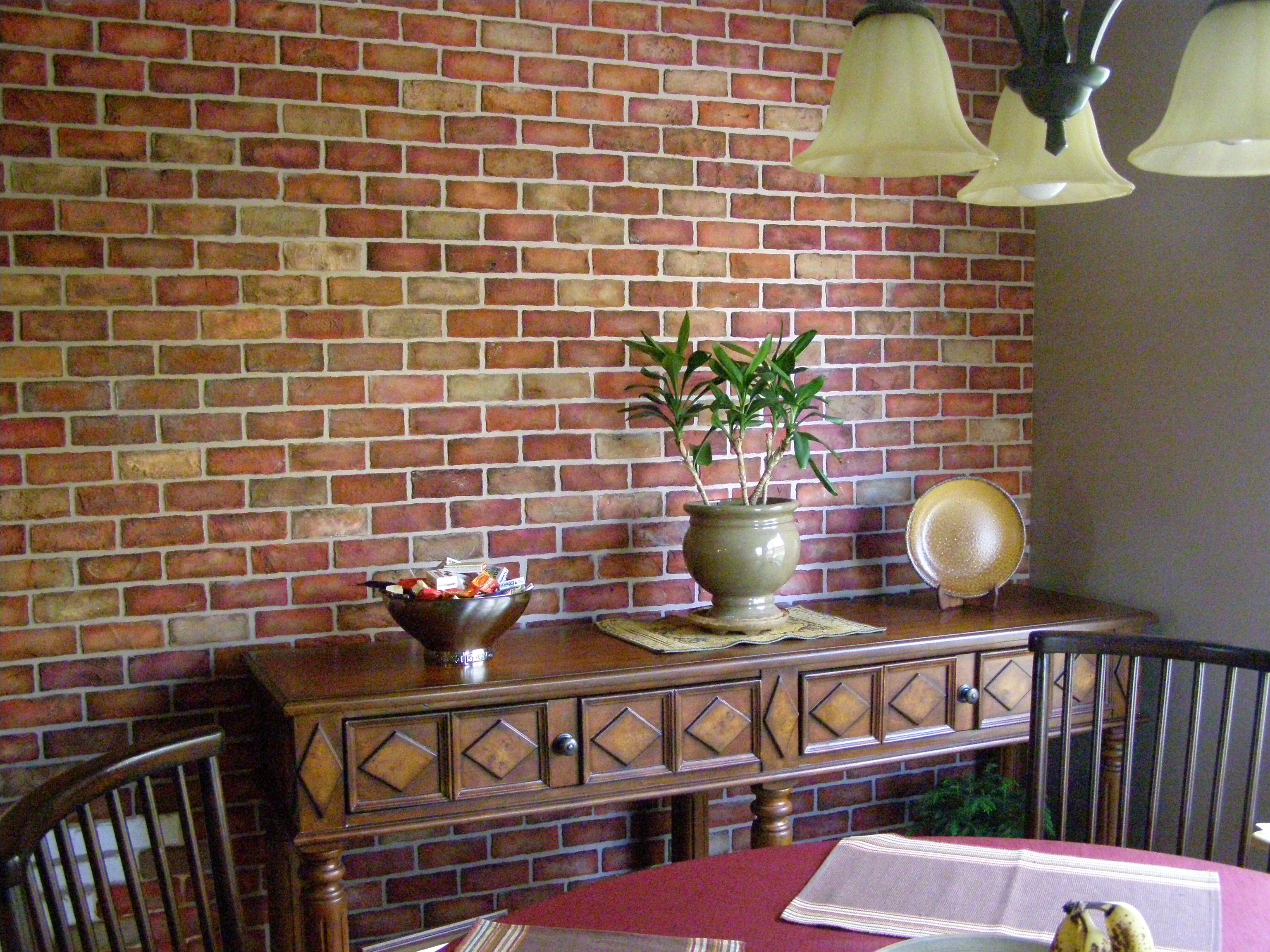 Faux brick wall I made using joint compound and a stencil Then