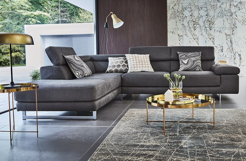 ... Appeal To Your Living Space With The Simple Form Trend. The Livita Sofa  Features Glossy Chrome Feet And Adjustable Headrests For Style And Comfort.