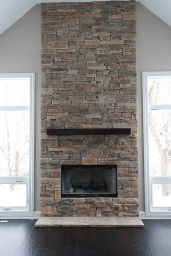 stone fire place, windows on each side, and put window benches