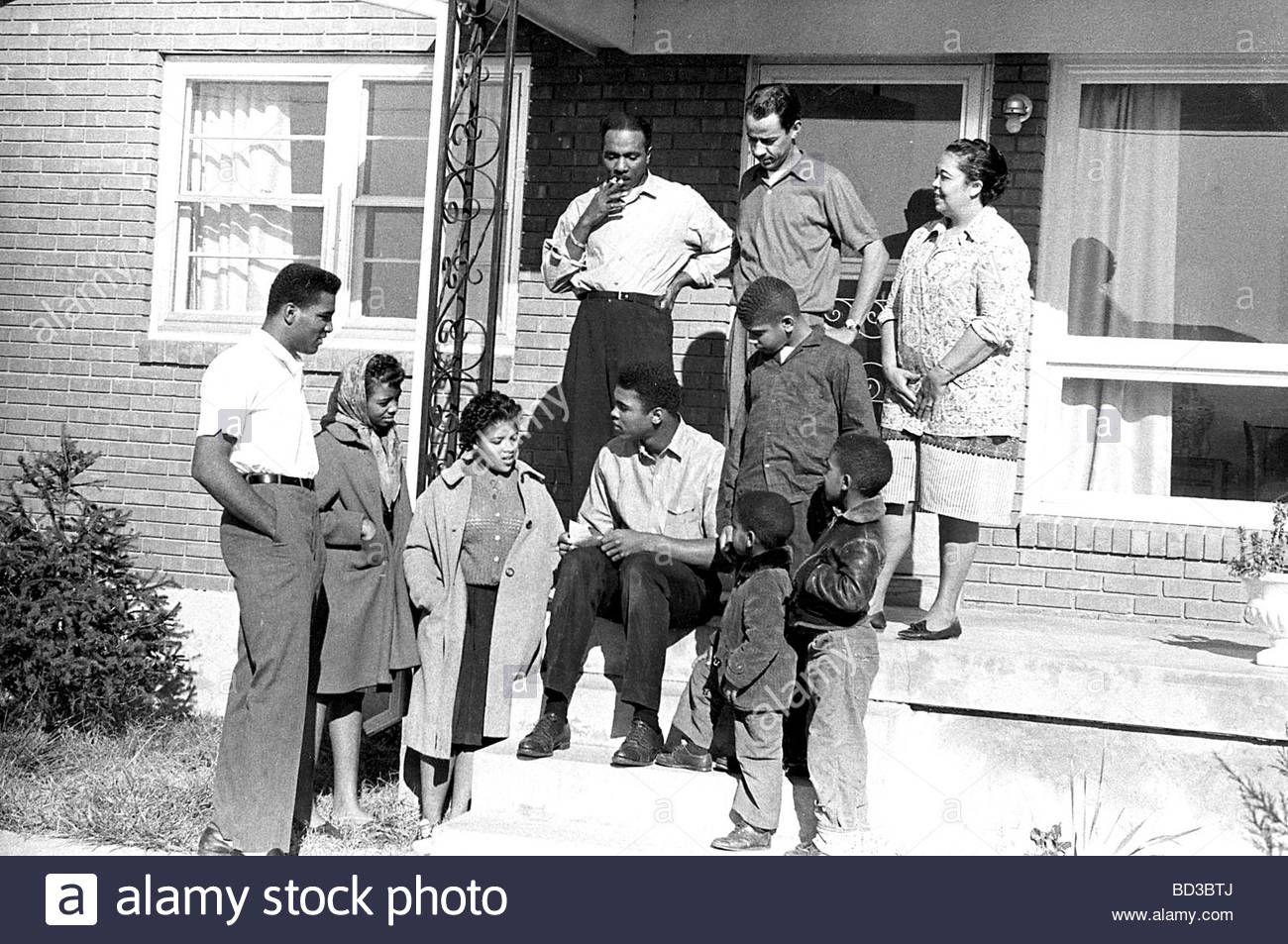 MUHAMMAD ALI Family and friends at their Louisville, Kentucky home, about 1965. On steps his father at left and mother at right Stock Photo