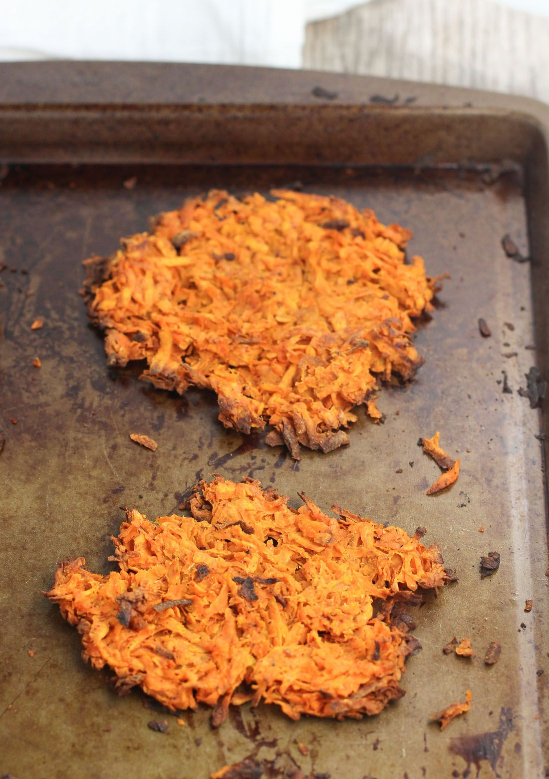 Spiced Sweet Potato Hash Browns - a spin on a breakfast favorite! These hash browns feature a warm spice blend and can be made two ways - either traditionally on the stovetop or baked for a lighter option!