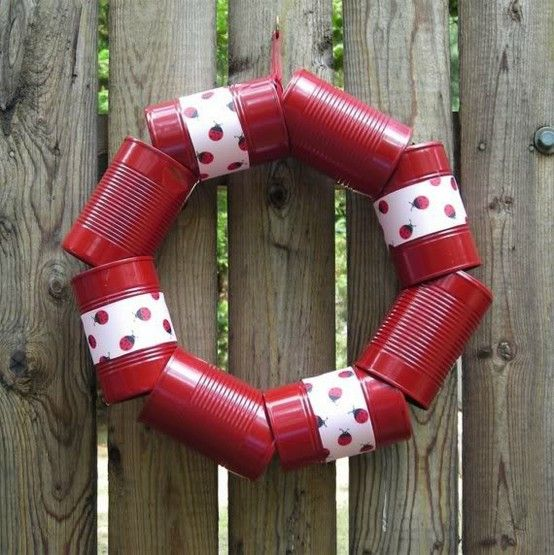 tin can wreath-maybe strung on a clothes hanger?