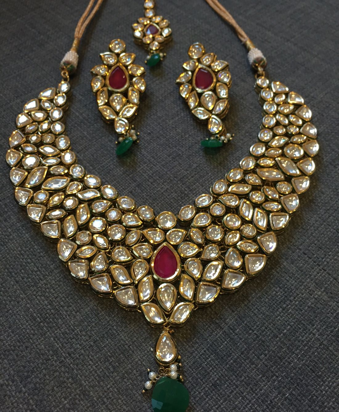 Kundan gold plated set with ruby style stones in invisible setting
