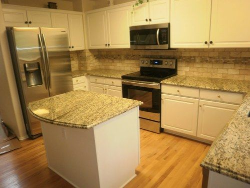 white subway tile backsplash with white santa granite countertops