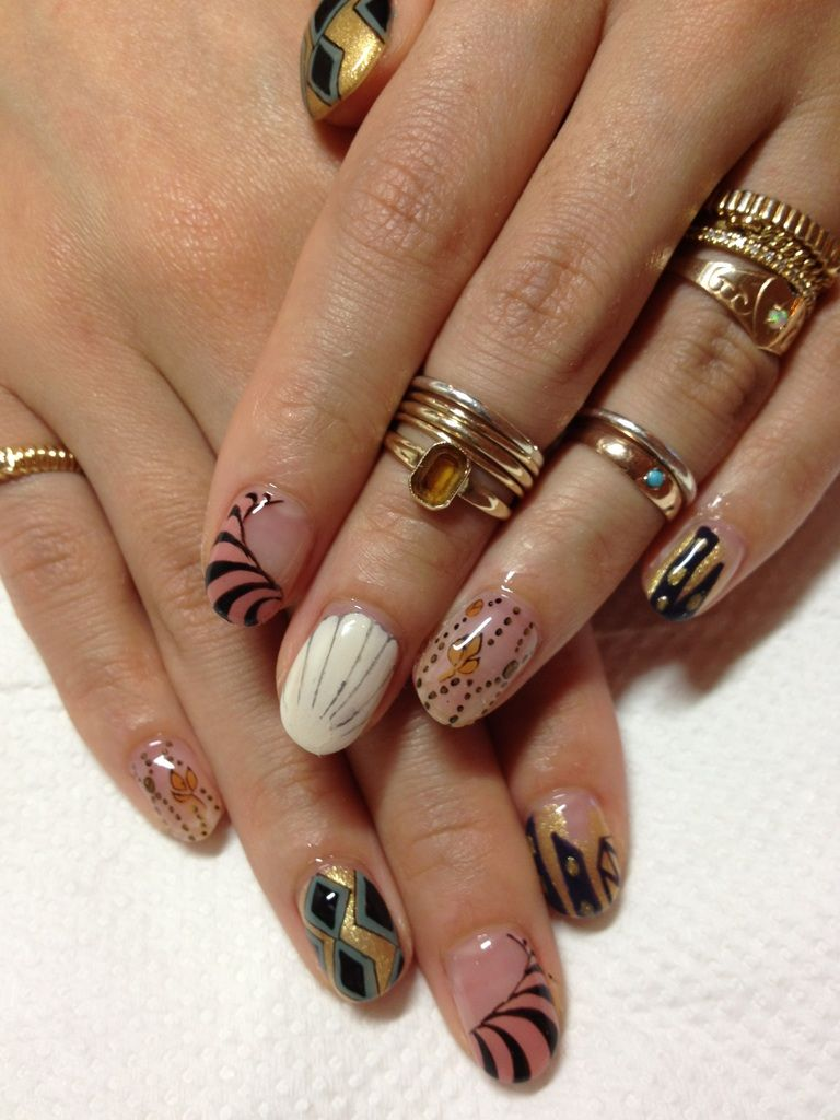 Beautiful fancy nail designs w/ gold rings.