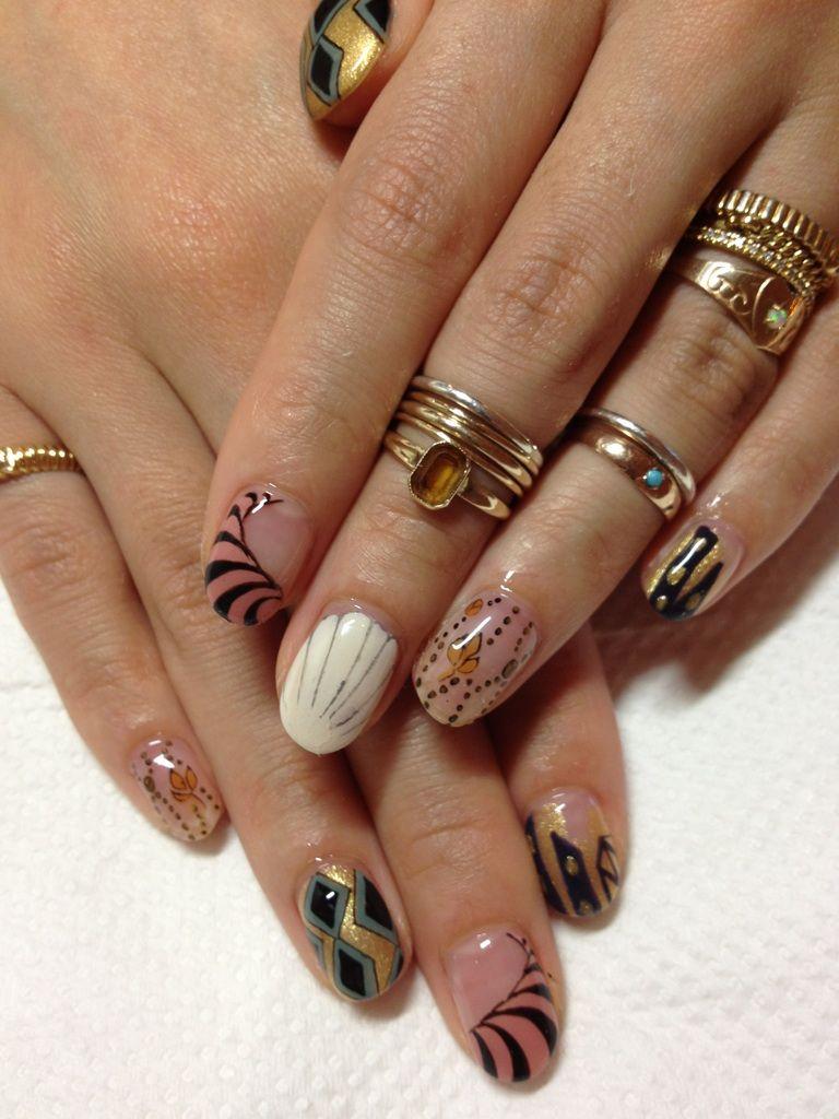 Beautiful fancy nail designs w/ gold rings.
