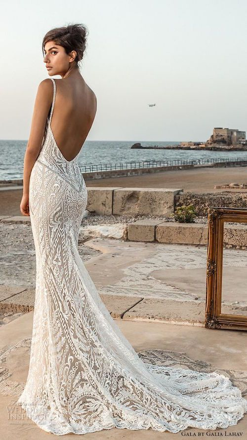 5c5db3a9f4c1 Sleeveless deep plunging V-neck fully embellished with elegant, sexy  backless lace fit and flare sheath wedding dress with chapel train.