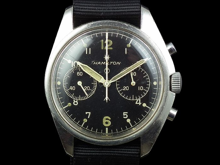 WORN & WOUND: 1970′s British Military Asymmetrical Chronographs---For over a decade, four companies – Hamilton, CWC, Newmark, and Precista – supplied simple, sturdy, 30-minute chronographs to the British military. Their classic black, 2-register dials, workhorse Valjoux 7733 movements, and asymmetrical case design led to high usability and keep them popular and influential In the early 1970s, while the United States grew its military in response to the conflict in Southeast Asia.