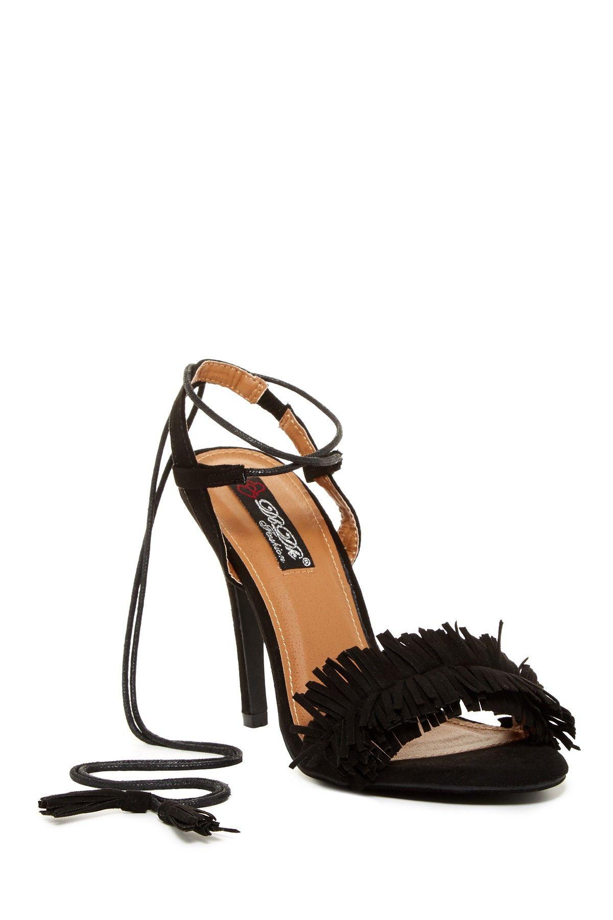 Fringe + lace-up = Shoe perfection.  Loving these heels!