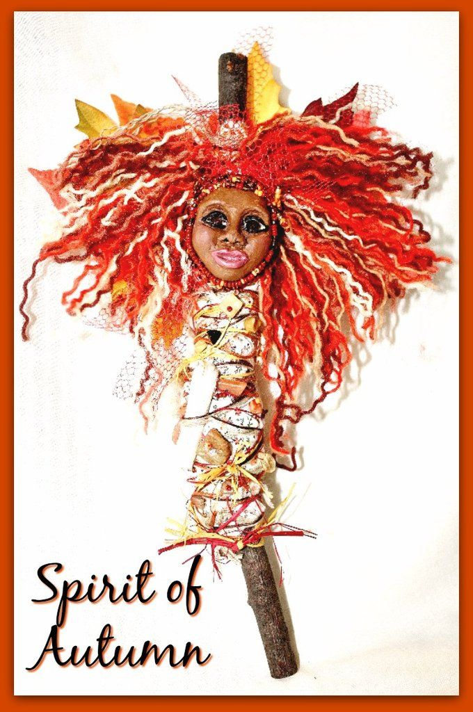 Spirit of Autumn Spirit Doll Her fiery mane is comprised of yarn, tulle, and silk leaves in fall colors. She is embroidered with the following gemstone chips: Tiger's eye, Carnelian, Citrine, Jasper