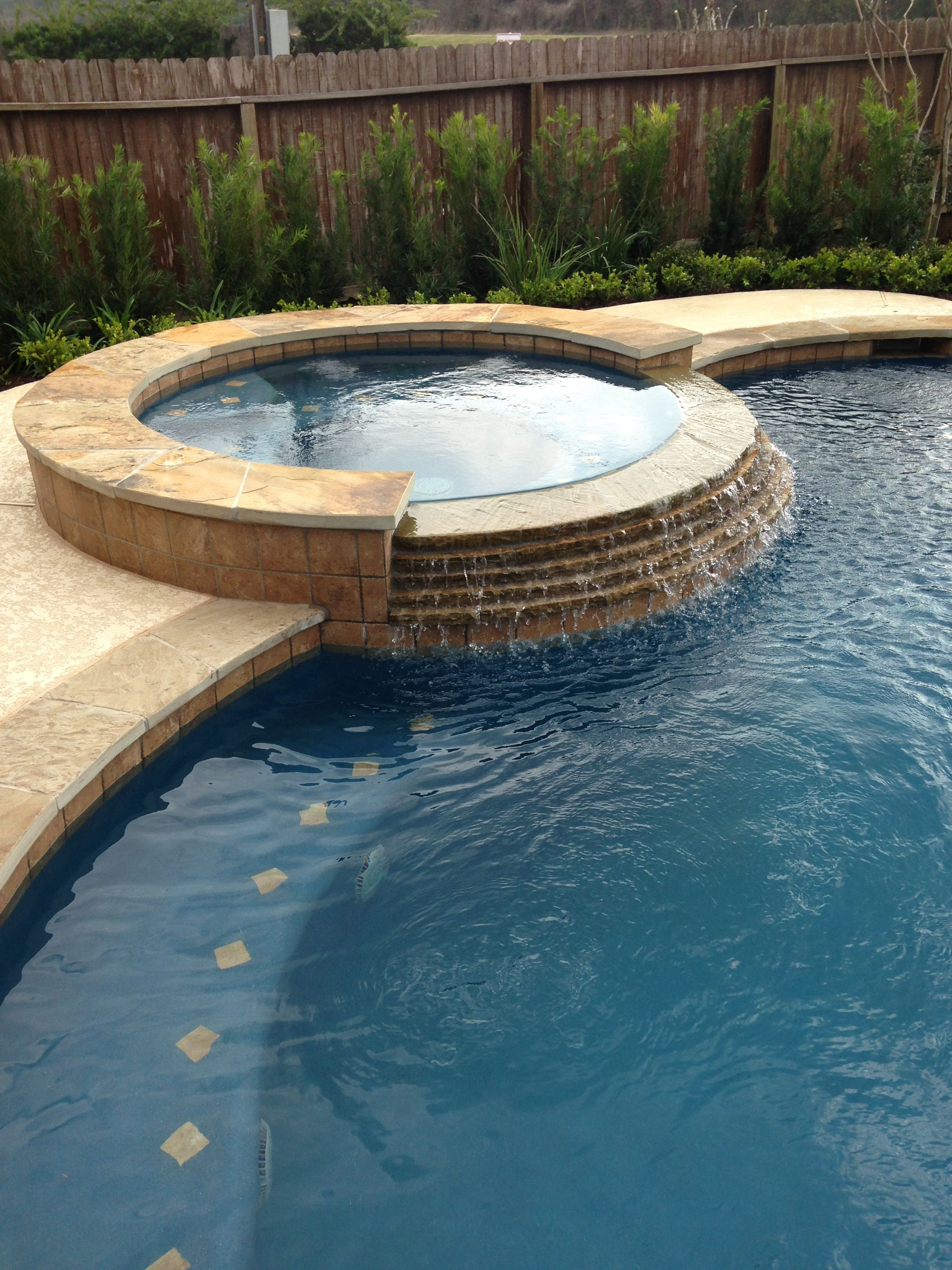 Inground swimming pool tile raised spa stacked stone spa for Swimming pool tile pictures