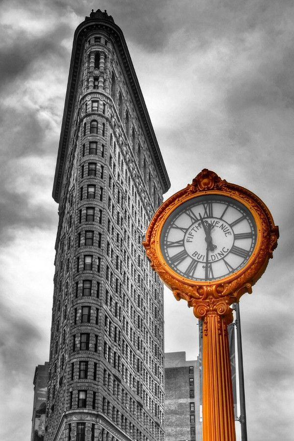 Golden clock in front of Flatiron building