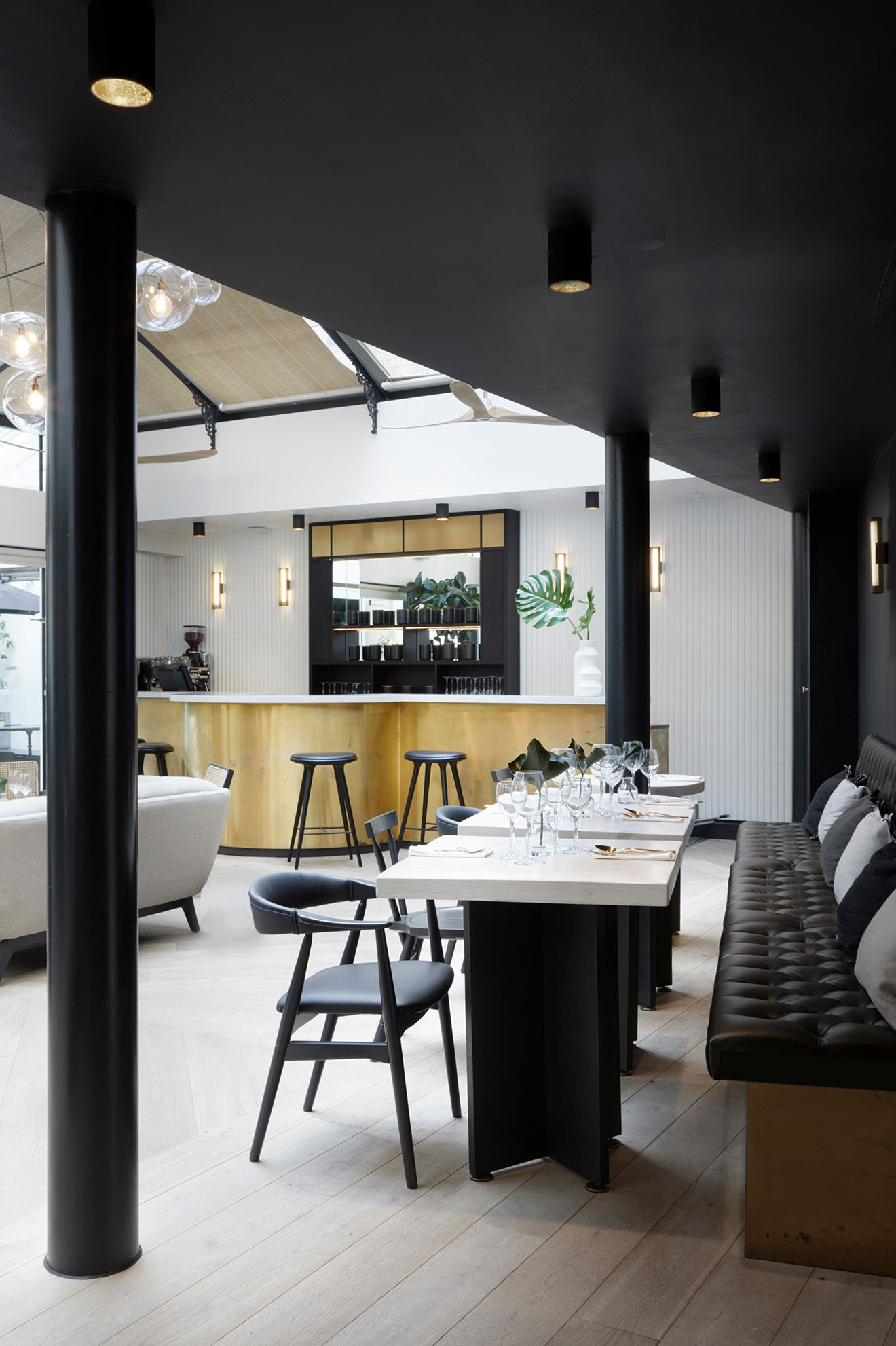 bdfeb586fcc96 Distressed brass bar with black wood barstools - My Hotels Group Chelsea boutique  hotel designed by
