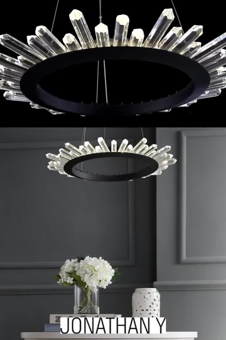 Combining the classic chandelier elements of metal and crystal, this pendant chandelier takes a modern turn by incorporating integrated LED lighting and rugged crystals emitting from the hoop shape like a starburst. #JonathanY #HomeDecor #Lamps #DesignerLamps #ModernLighting #CeilingLighting #PendantLighting