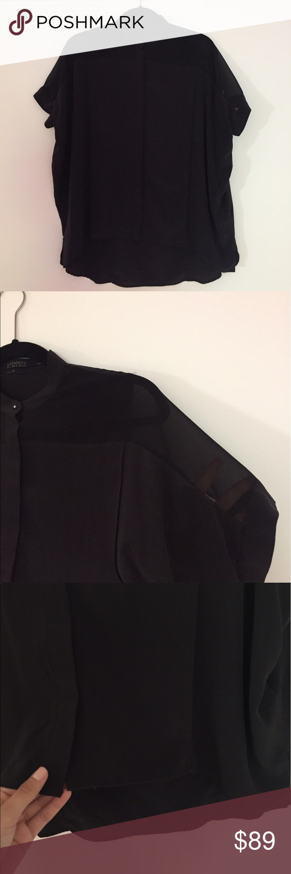 short sleeve black button up silk top short sleeve black button up top from all saints. 100% silk. high low style. top button is silver. top panels are sheer. All Saints Tops Blouses