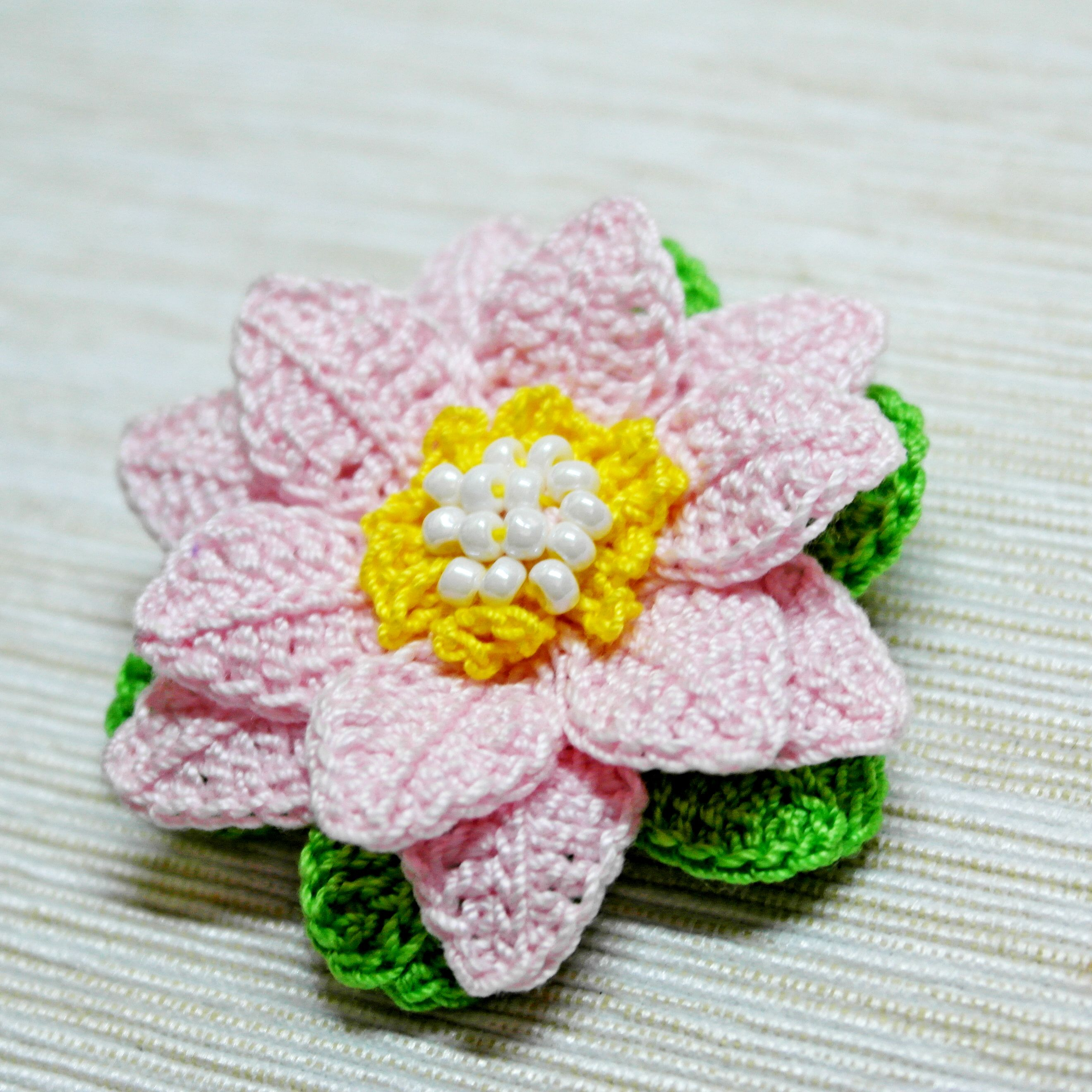 double slouch stitch crocodile pin and crocheted layered flowers reversible textured brooch