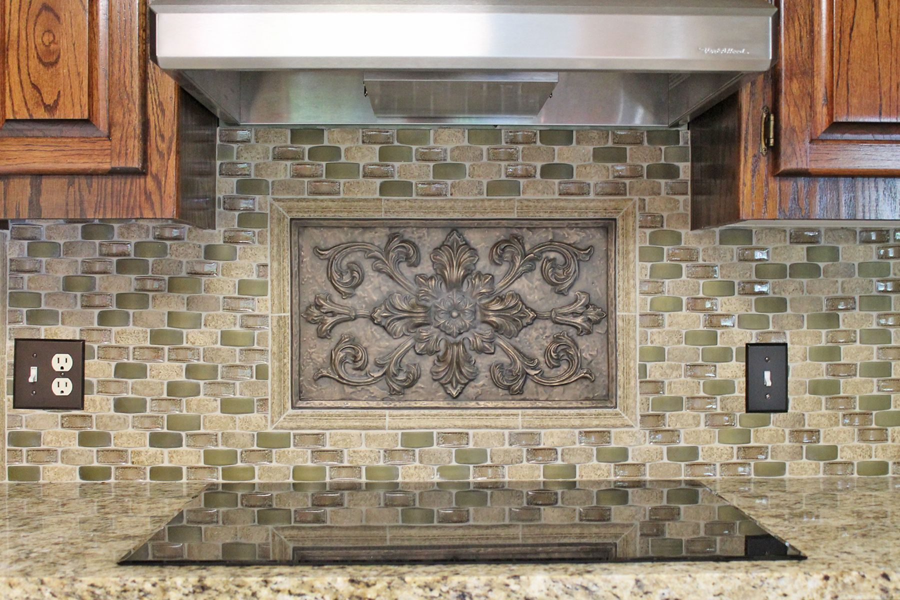Kitchen backsplash idea graytaupegreen mosaic tile with bronze kitchen backsplash idea graytaupegreen mosaic tile with bronze accent piece dailygadgetfo Image collections