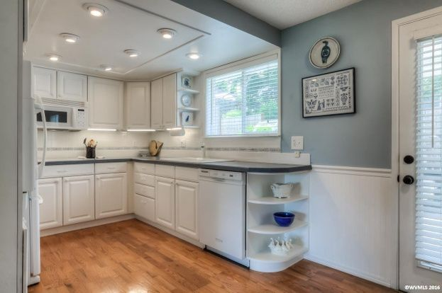 Drop the ceiling over the kitchen to camouflage the ...