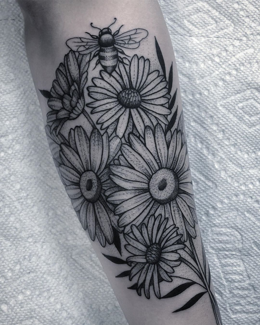 Daisies Asters And A Bee For The Sweetest Alyson Bee And Flower Tattoo Daisy Tattoo Aster Flower Tattoos