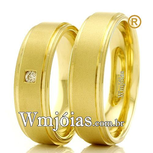 Aliança de noivado e casamento Aliança em ouro amarelo 18k 750 Peso: 8 gramas o par Pedras: 1 diamante de 1 ponto http://www.wmjoias.com.br/