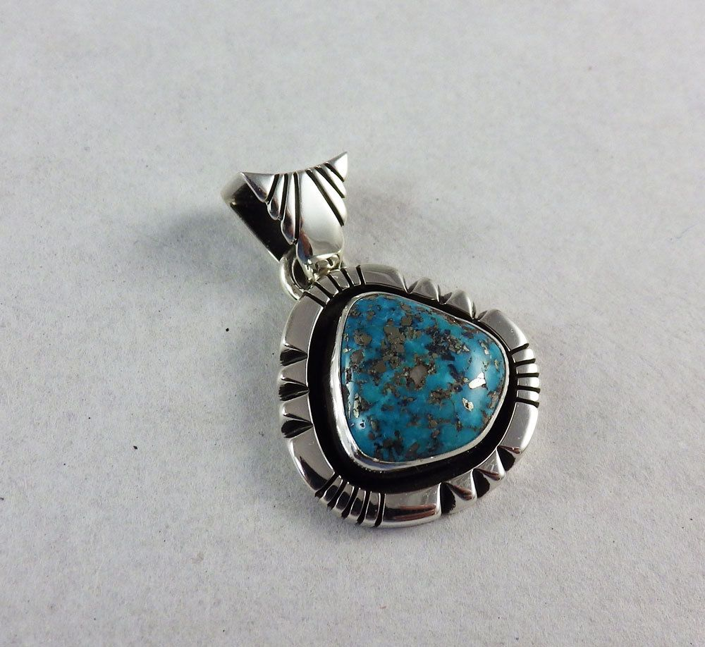 A vintage morenci turquoise is set in a modern sterling silver