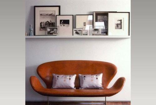 Kunstgalerie mit Bilderrahmen an der Wand wohnzimmer sofa To hang